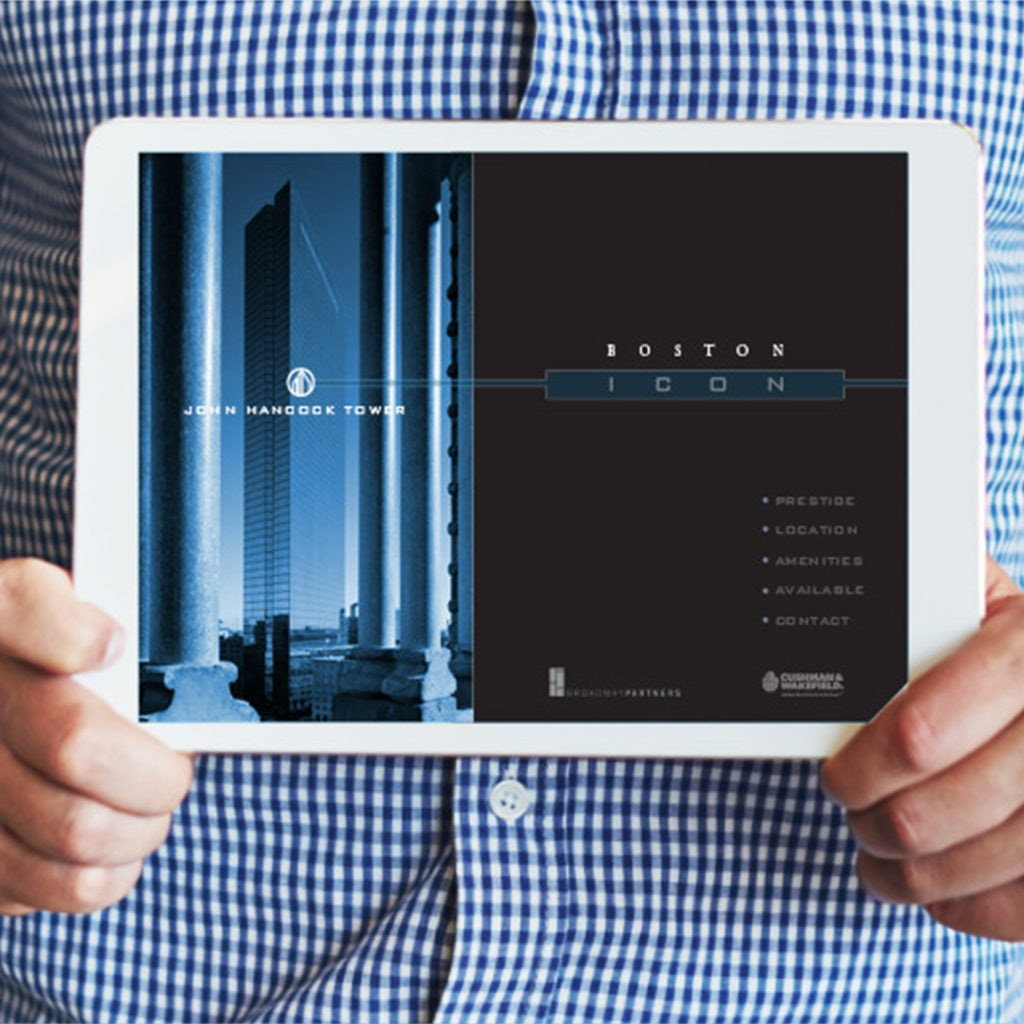 A redesigned website showing the John Hancock Tower is presented on an iPad.