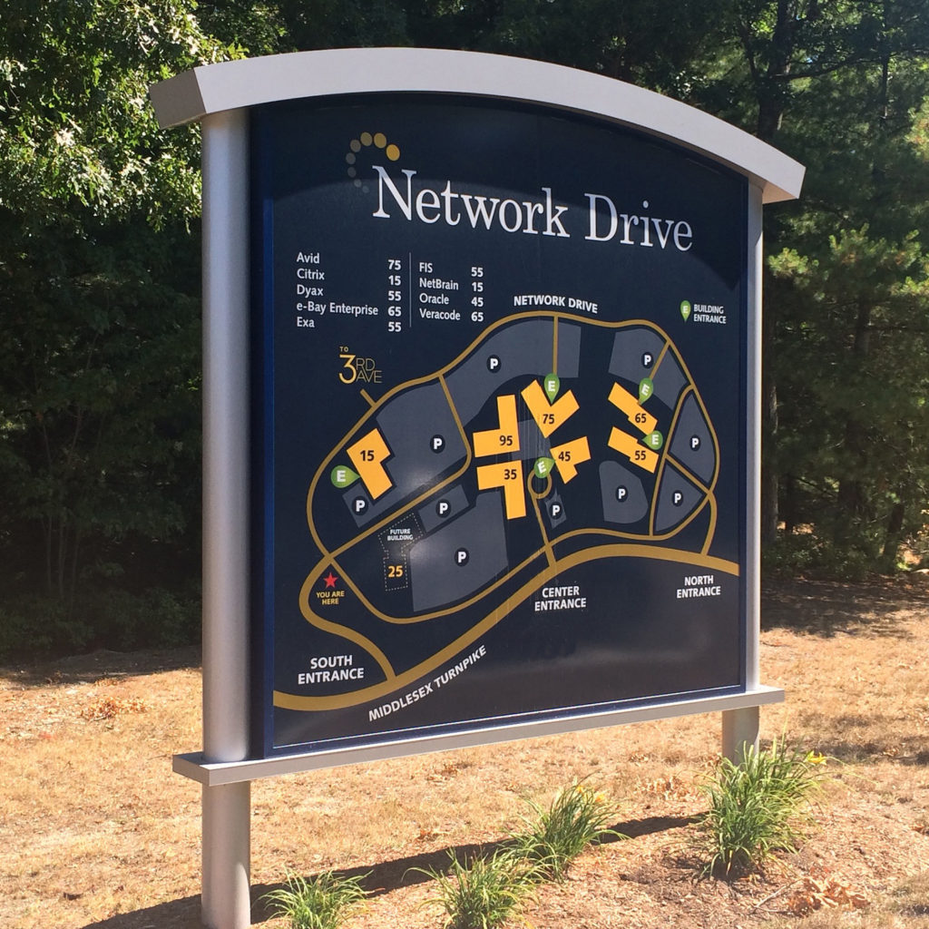 A map of the Network Drive business park shows different entrances off Middlesex Turnpike and individual building locations within the park.