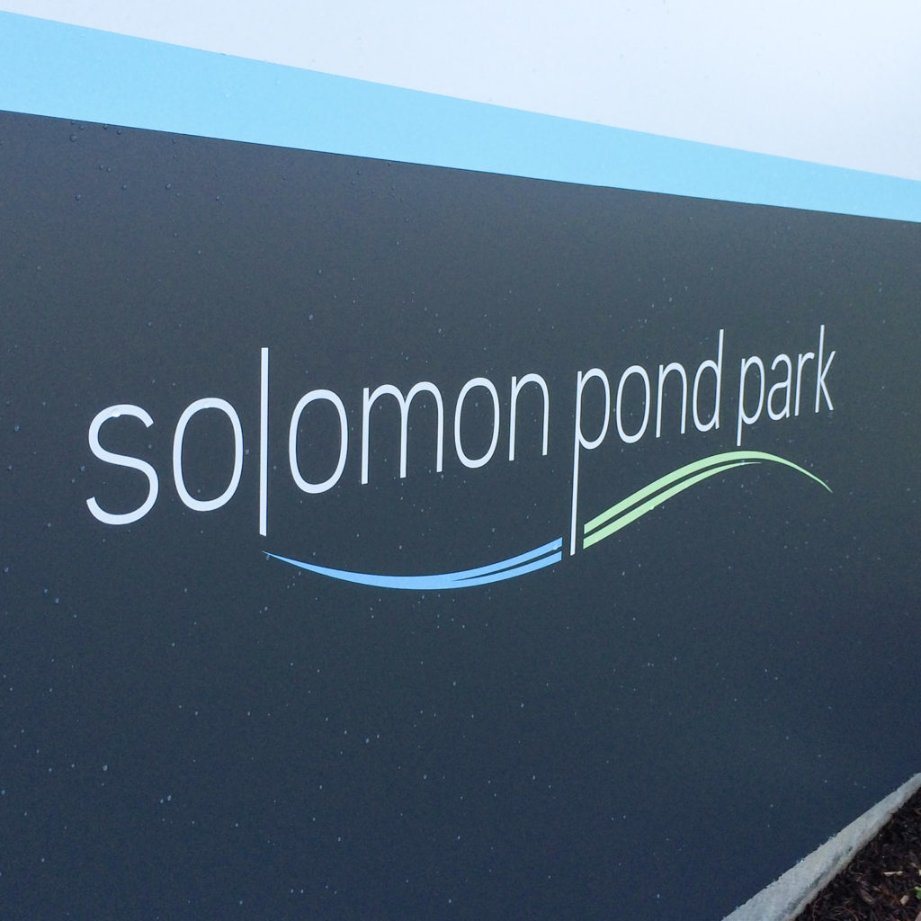Solomon Pond Park visitors are welcomed by a large, outdoor sign.