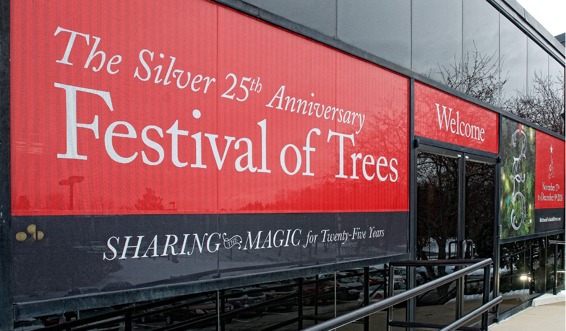 Billboard advertising promotes the Festival of Trees.