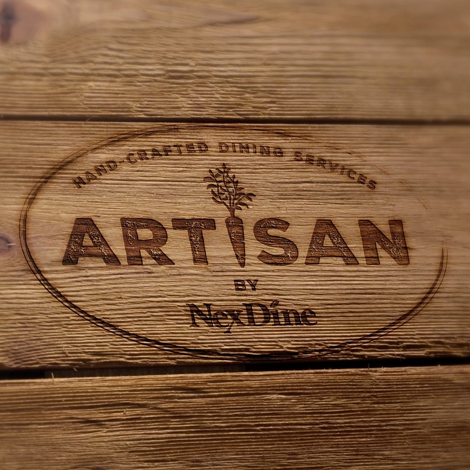 One element of a branding campaign for Artisan by NexDine is a hand-crafted cutting board.