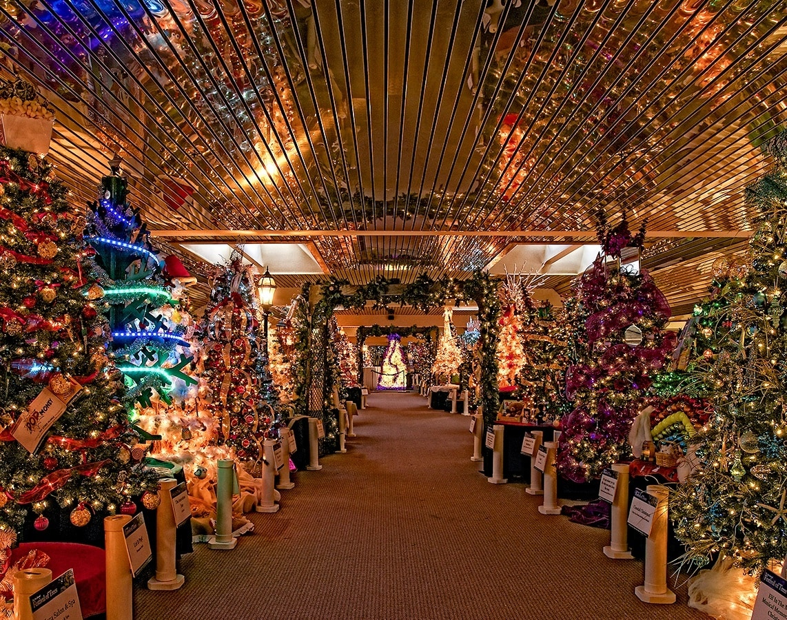 Rows of beautifully, thematic holiday trees line the corridor at the Festival of Trees in Methuen, Massachusetts