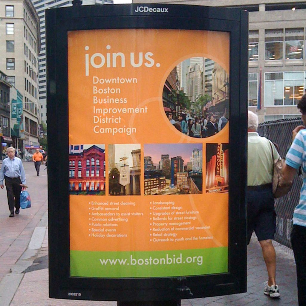 A downtown Boston billboard invites local businesses to take part in the Downtown Boston Business Improvement District Campaign.