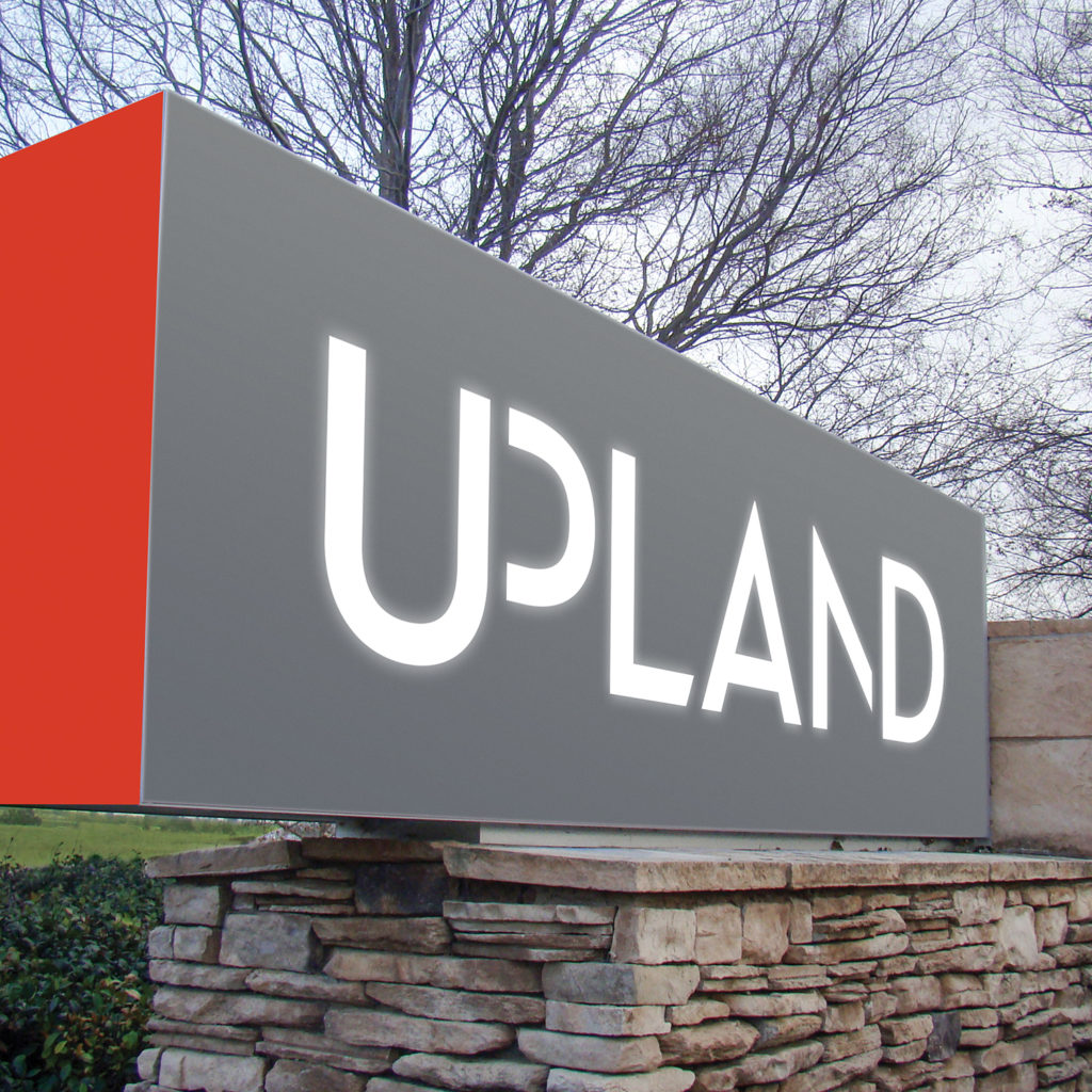 Outdoor building signage for Upland guides employees and visitors into the parking lot.