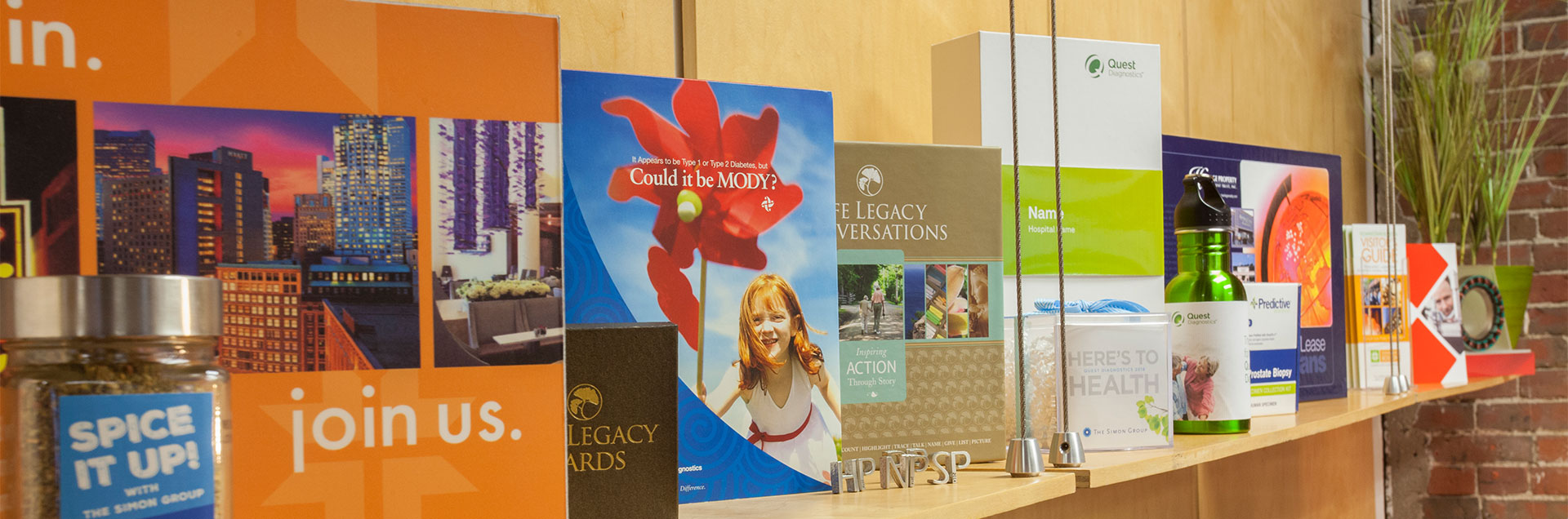 Marketing communications collateral on display at The Simon Group.