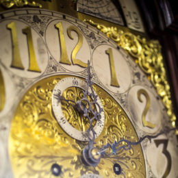 An intricately designed clock is displayed in the executive office.