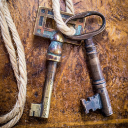 A set of keys is strung from a piece of rope.