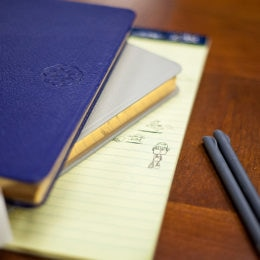Notes and ideas from client meetings are documented in notebooks.