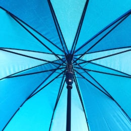 Employee swag at The Simon Group now includes umbrellas for those rainy, April days.